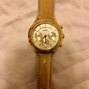 DKNY   Gold and leather watch